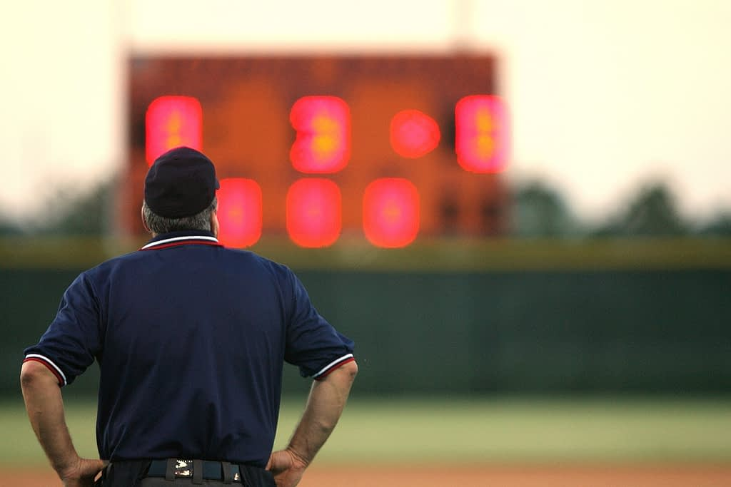 Man looking at scoreboard