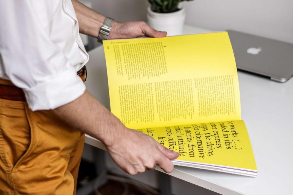 Colorman man looking at book